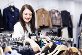 Brunette girl at clothing store — Stock Photo