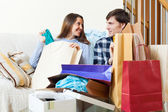 Woman and man with shopping bags — Stock Photo