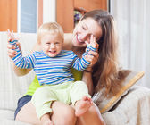 Portrait of happy mom with toddler  — Stock Photo