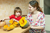 Mother with daughter cooking pumpkin   — Stock Photo