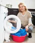 Housewife using washing machine — Stock Photo