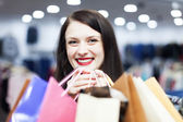 Girl in the shopping mall — Stock Photo