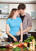 Couple hugging in the kitchen — Stock Photo