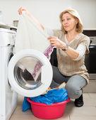 Woman doing laundry — Stock Photo