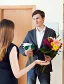Woman get bunch of flowers — Stock Photo