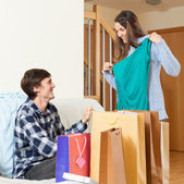Young couple with purchases — Stock Photo