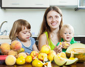 Mother with children eating — Stock Photo