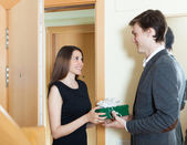 Girl came to man with gift  — Stock Photo