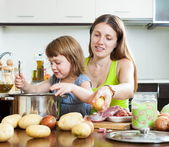 Happy mother with child cooking — Stock Photo