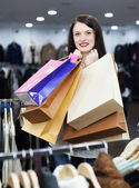 Female customer at fashion boutique — Stock Photo