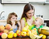 Woman with  daughters eating — Stock Photo