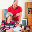 Couple calculating family budget — Stock Photo