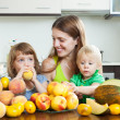 Smiling family together with melon — Stock Photo