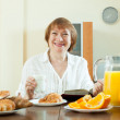 Mature  woman having breakfast — Stock Photo #47100293