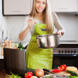 woman  using notebook while cooking soup   — Stock Photo #47100635