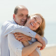Elderly couple at sea shore — Stock Photo #47100791