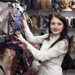 Girl chooses bag at shop — Stock Photo #47100797