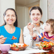 Mature woman and daughter eats — Stock Photo