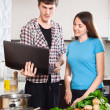 Man shows the new recipe to girl — Stock Photo #47101195