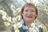 senior woman  in spring willow   — Stock Photo