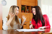 Happy women with  documents  at table — Stock Photo