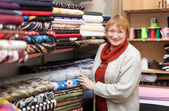 Woman at fabric store — Stock Photo
