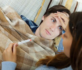 Woman caring for sick guy — Stock Photo