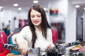 Happy buyer at clothing store — Stockfoto