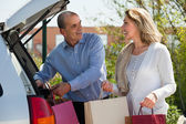 Husband and wife with shopping bags — Stock Photo