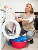 Woman using washing machine — Stock Photo