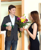 Man giving a gift box to his young wife — Stock Photo