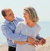 Elderly man hugging woman — Stock Photo
