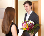 Young couple greeting in the doorway  — Stock Photo