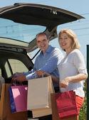 Senior spouses with bags — Stock Photo