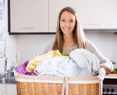 Happy woman with large linen basket  — Foto de Stock