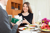 Man giving present to woman   — Stock Photo