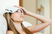 Girl with wet towel on forehead — Stock Photo