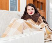 Woman warming near electric heater — Stock Photo