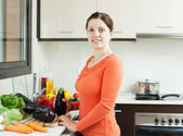 housewife cooking  vegetables  with aubergines   — Stock Photo