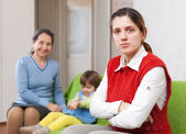 Sadne mother and grandmother with baby — Stock Photo