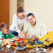 Man with son doing something with working tools — Stock Photo