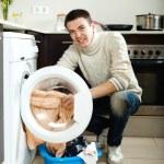 Guy with washing machine — Stock Photo
