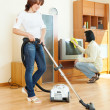Amicable couple doing housework   — Stock Photo #47124321