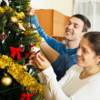Man and woman decorating Christmas tree — Stock Photo #47125161