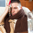 Sad  man having headache holding towel on head — Stock Photo #47126207
