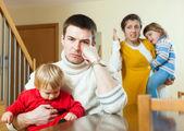 Family of four having quarrel at home — Stock Photo