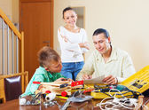 Man with son doing something with the working tools — Stock Photo