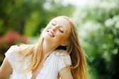 Enjoying blonde woman   — Stock Photo