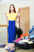 woman choosing dress for rest — Stock Photo