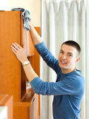 Handsome man cleaning  furniture — Stock Photo